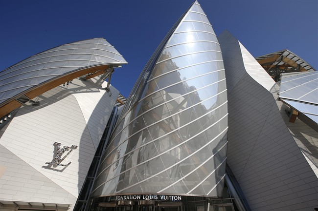 The Louis Vuitton Foundation building is pictured before the presentation of Louis Vuitton's Spring/Summer 2015 ready-to-wear fashion collection in Paris, France, Wednesday, Oct. 1, 2014. The foundation, designed by American architect Frank Gehry, will open its doors to the public on Oct. 27 , 2014. (AP Photo/Francois Mori)