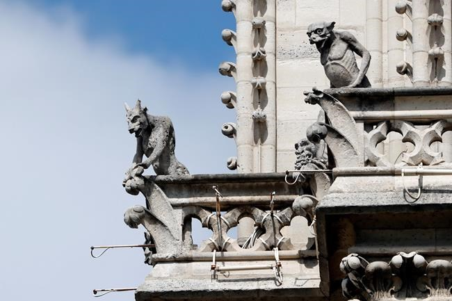 """Preserved gargoyles of Notre Dame cathedral are pictured Wednesday, April 17, 2019 in Paris. Notre Dame Cathedral would have been completely burned to the ground in a """"chain reaction collapse"""" had firefighters not moved rapidly in deploying their equipment to battle the blaze racing through the landmark monument, a Paris official said Wednesday. (AP Photo/Thibault Camus)"""
