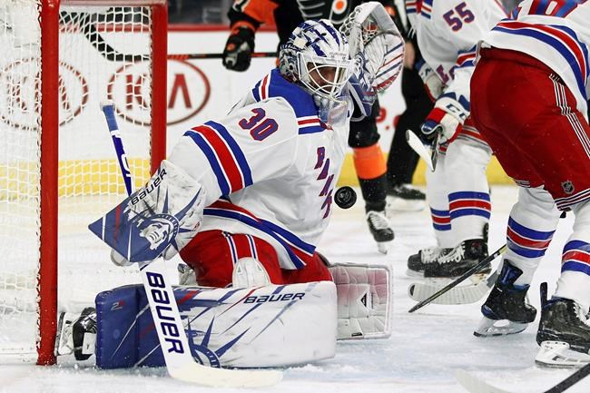New York Rangers' Henrik Lundqvist turns away a shot on goal during the second period of an NHL hockey game against the Philadelphia Flyers, Monday, Dec. 23, 2019, in Philadelphia. (AP Photo/Tom Mihalek)