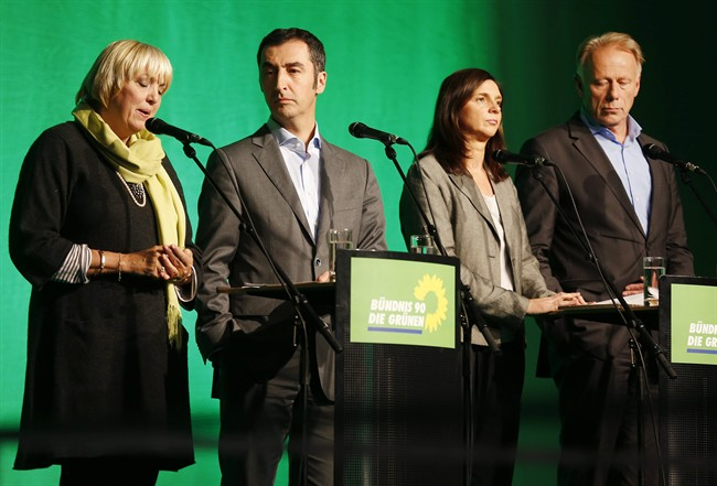 Green Party leaders Claudia Roth and Cem Ozdemir, and top candidates of Sunday's elections Katrin Goering-Eckardt and Juergen Trittin, from left, stand together during a press conference of the Green party on Monday, Sept. 23, 2013, one day after the German elections. (AP Photo/Michael Probst)