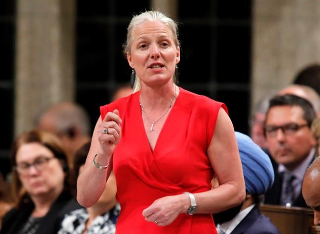 Minister of Environment and Climate Change Catherine McKenna rises in the House of Commons during Question Period in Ottawa on Thursday, June 7, 2018. THE CANADIAN PRESS/ Patrick Doyle