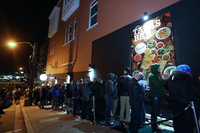 An estimated 400 people were in line to purchase cannabis at the Tweed retail store on Water Street, St. John's N.L. when it became legal after midnight on Wednesday, October 17, 2018. (Paul Daly / The Canadian Press files)