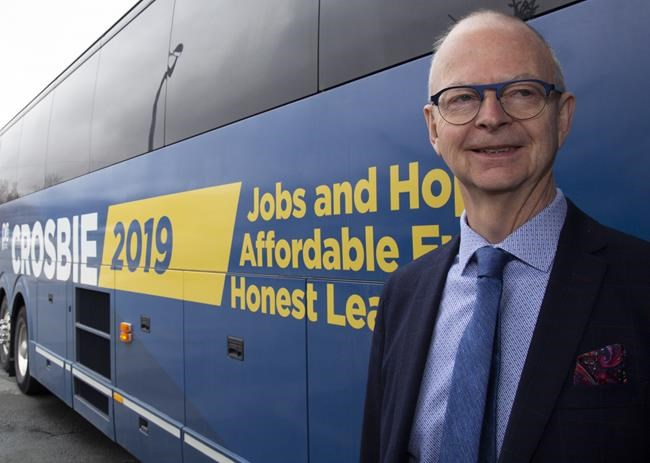 Ches Crosbie, leader of the Provincial Progressive Conservative party in front of his campaign bus in St. John's on Sunday, May 12, 2019. THE CANADIAN PRESS/Paul Daly