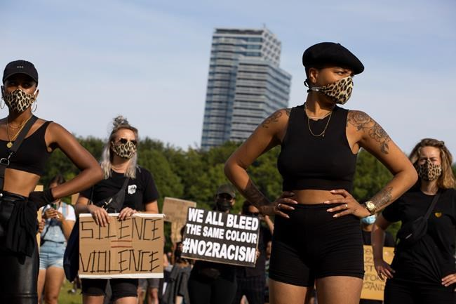 People observe social distancing as they take part in a demonstration in The Hague, Netherlands, Tuesday, June 2, 2020, to protest against the recent killing of George Floyd, police violence and institutionalized racism. Floyd, a black man, died in police custody in Minneapolis, U.S.A., after being restrained by police officers on Memorial Day. (AP Photo/Peter Dejong)