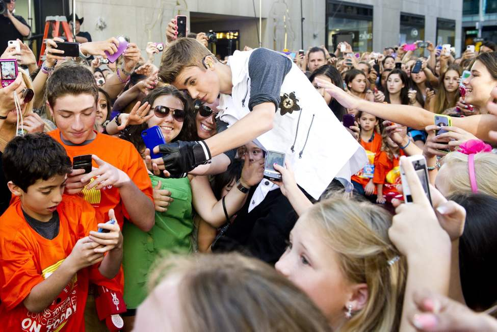 """Justin Bieber performs on NBC's """"Today"""" show on Friday, June 15, 2012 in New York.  (Charles Sykes / Invision/ The Associated Press)"""