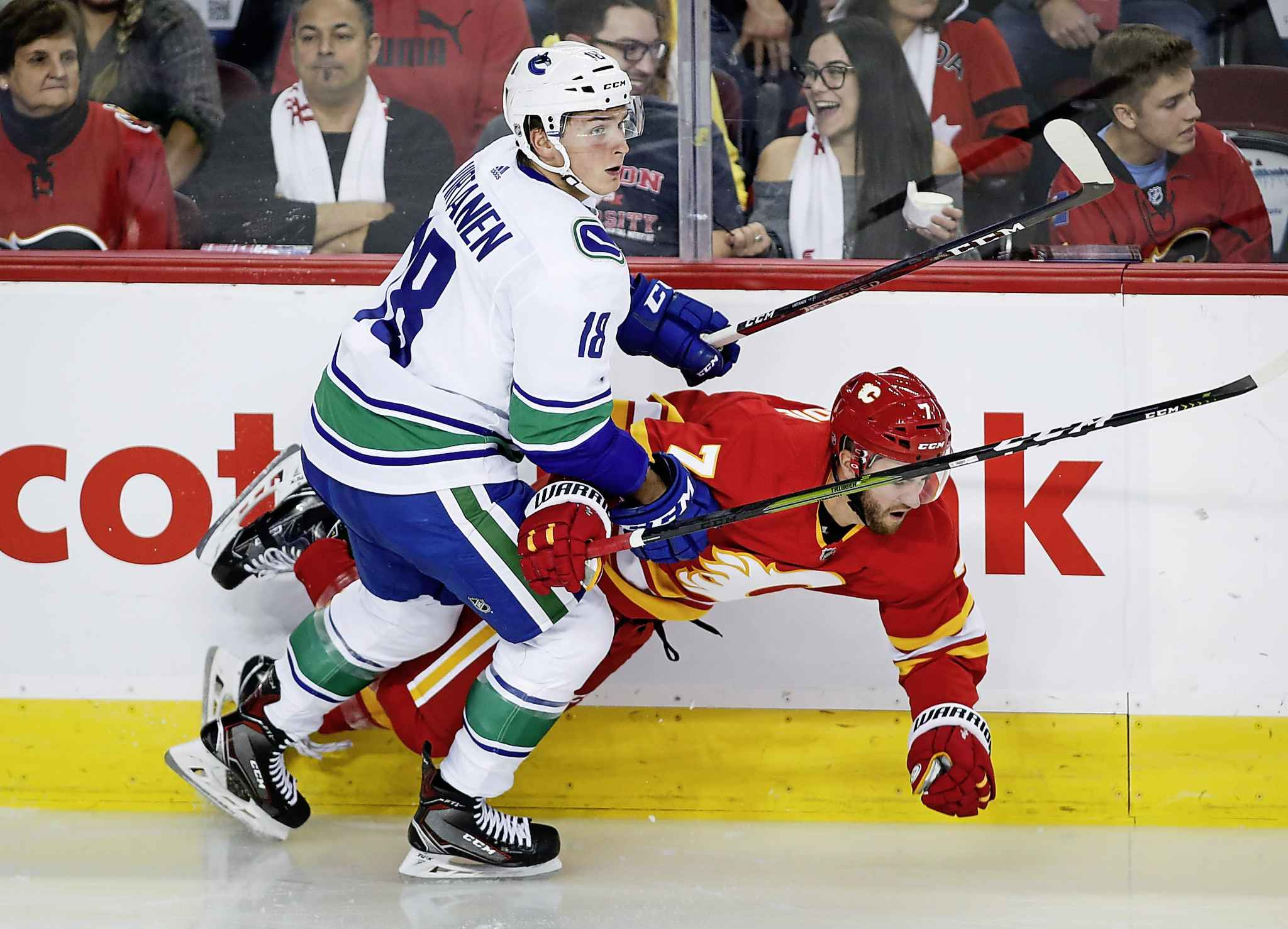 Vancouver's Jake Virtanen, left, is listed by the NHL as 6-1 and 226 compared to Perreault who is 5-10 and 188 pounds.