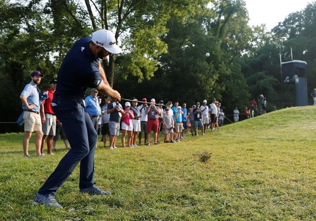 Dustin Johnson hits to the 12th green during the second round of the PGA Championship golf tournament at Bellerive Country Club, Friday, Aug. 10, 2018, in St. Louis. (AP Photo/Jeff Roberson)