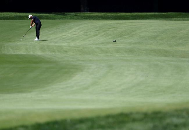 Brooks Koepka hits on the eighth fairway during the second round of the PGA Championship golf tournament at Bellerive Country Club, Friday, Aug. 10, 2018, in St. Louis. (AP Photo/Jeff Roberson)