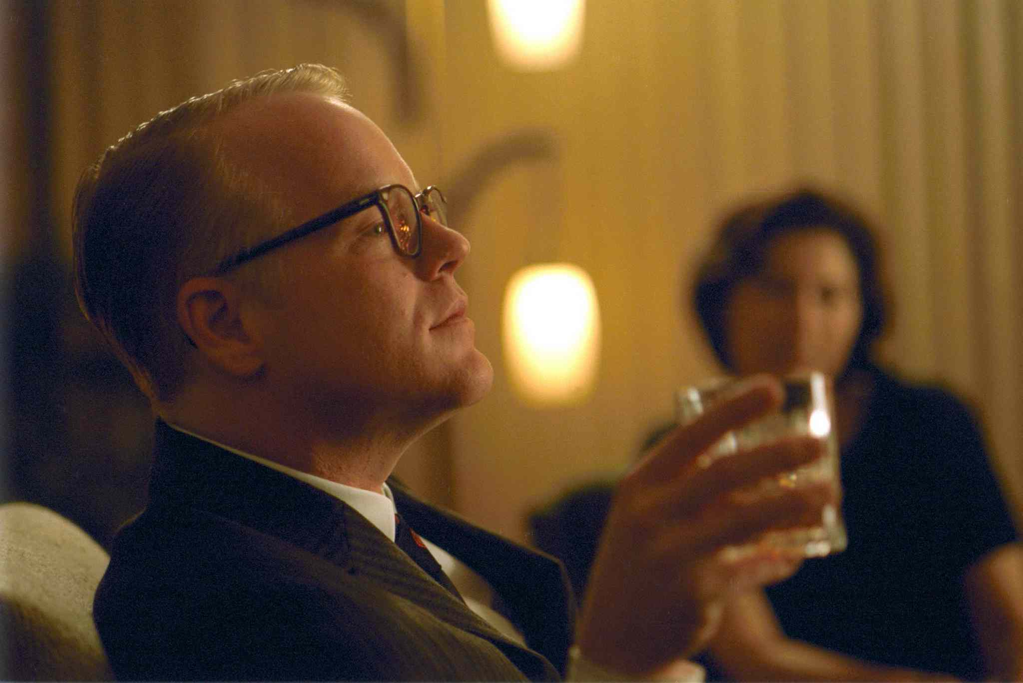 Philip Seymour Hoffman as Truman Capote in