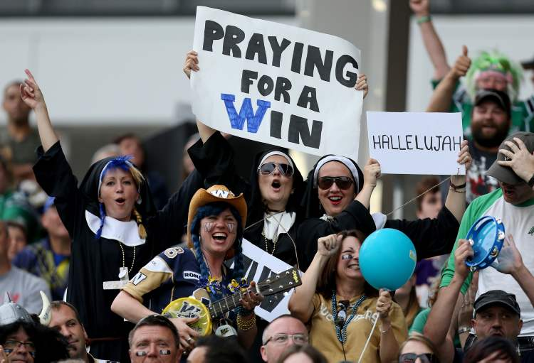 Winnipeg Blue Bombers' fans celebrate as the team played to their victory over the Saskatchewan Roughriders in the Banjo Bowl.