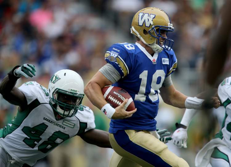 Saskatchewan Roughrider Renauld Williams (48) chases Winnipeg Blue Bomber quarterback Justin Goltz (18) during the Banjo Bowl Sunday. (Trevor Hagan / Winnipeg Free Press)