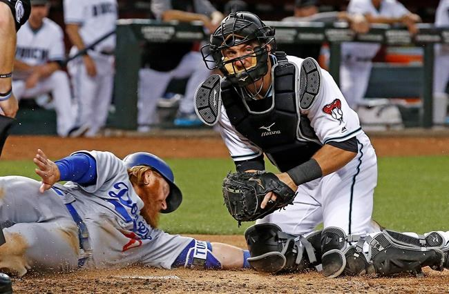 Backs score 9 runs in 8th, rout Dodgers 13-5
