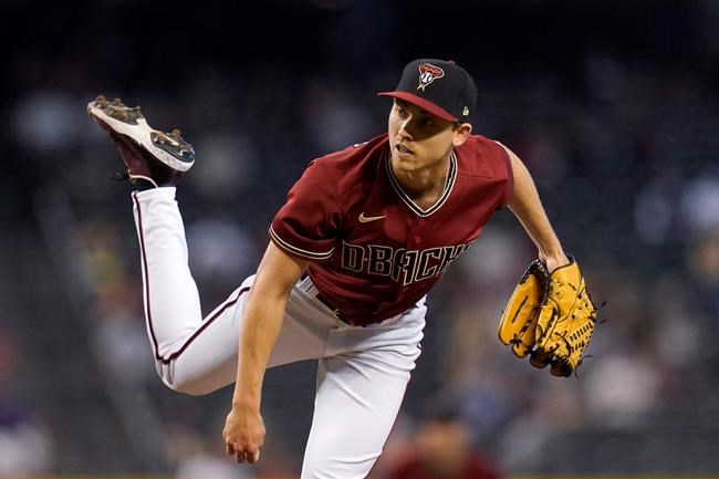Arizona Diamondbacks starting pitcher Luke Weaver throws against the Cincinnati Reds during the first inning of a baseball game Sunday, April 11, 2021, in Phoenix. (AP Photo/Ross D. Franklin)