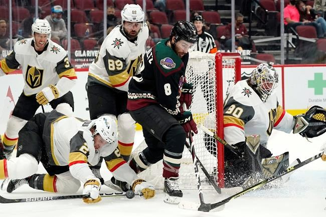 Arizona Coyotes center Nick Schmaltz (8) loses the puck as he tries to skate past Vegas Golden Knights defenseman Zach Whitecloud (2) and right wing Alex Tuch (89) as defenseman Brayden McNabb (3) and goaltender Robin Lehner (90) look on during the first period of an NHL hockey game Friday, April 30, 2021, in Glendale, Ariz. (AP Photo/Ross D. Franklin)