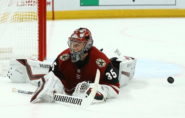 Arizona Coyotes goaltender Darcy Kuemper gives up a goal to New York Islanders' Joshua Ho-Sang during the first period of an NHL hockey game Tuesday, Dec. 18, 2018, in Glendale, Ariz. (AP Photo/Ross D. Franklin)