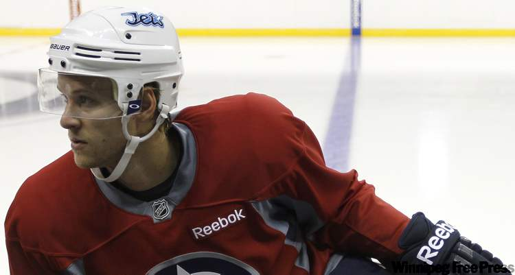 Paul Postma, seen here during Winnipeg Jets practice at in September 2011, has been recalled to the team from the St. John's IceCaps.