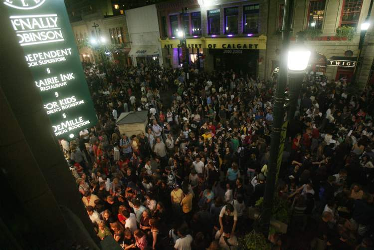 July 21, 2007, Calgary: thousands of people crowd Stephen Avenue for the Harry Potter book release party outside of McNally-Robinson Booksellers. Harry Potter and the Deathly Hallows went on sale at midnight.   (Ted Rhodes / Postmedia News Archives)