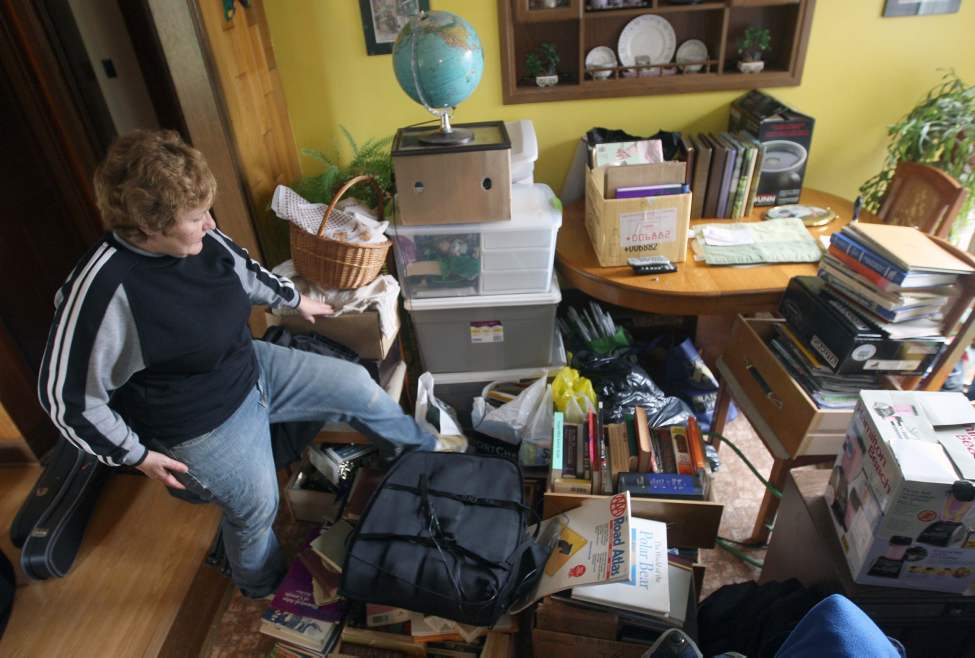Yvonne Kriski hauls all her possessions to her main floor from the basement Tuesday. She lives east of Portage La Prairie near the Hoop and Holler Bend. The province plans to cut Hwy 331 and release flood waters into the lower land where their home is. May 10, 2011 (JOE BRYKSA/WINNIPEG FREE PRESS)