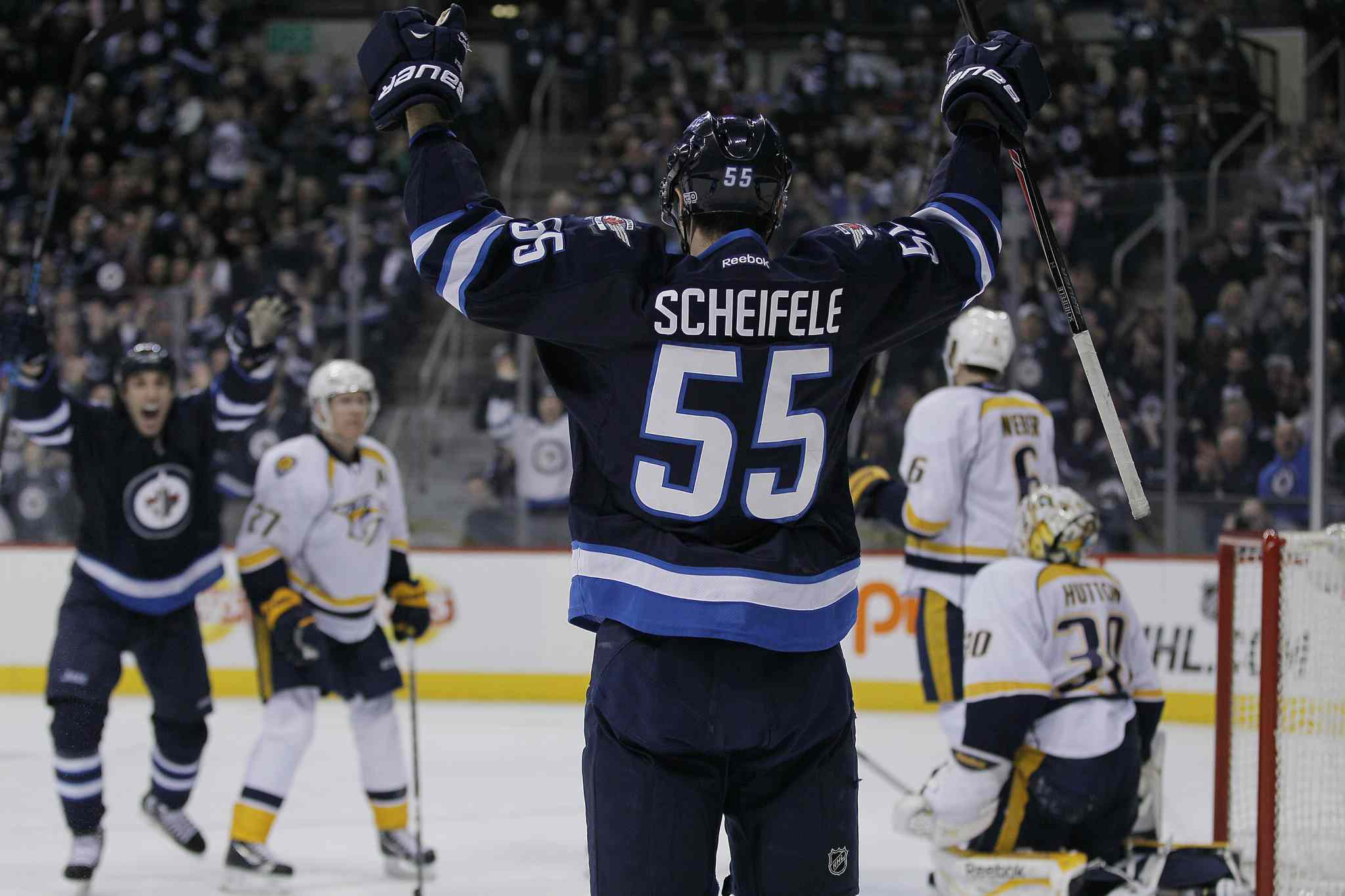 Winnipeg Jets' Mark Scheifele (55) celebrates his second-period goal on Nashville Predators' goaltender Carter Hutton (30) during Tuesday's game in Winnipeg.
