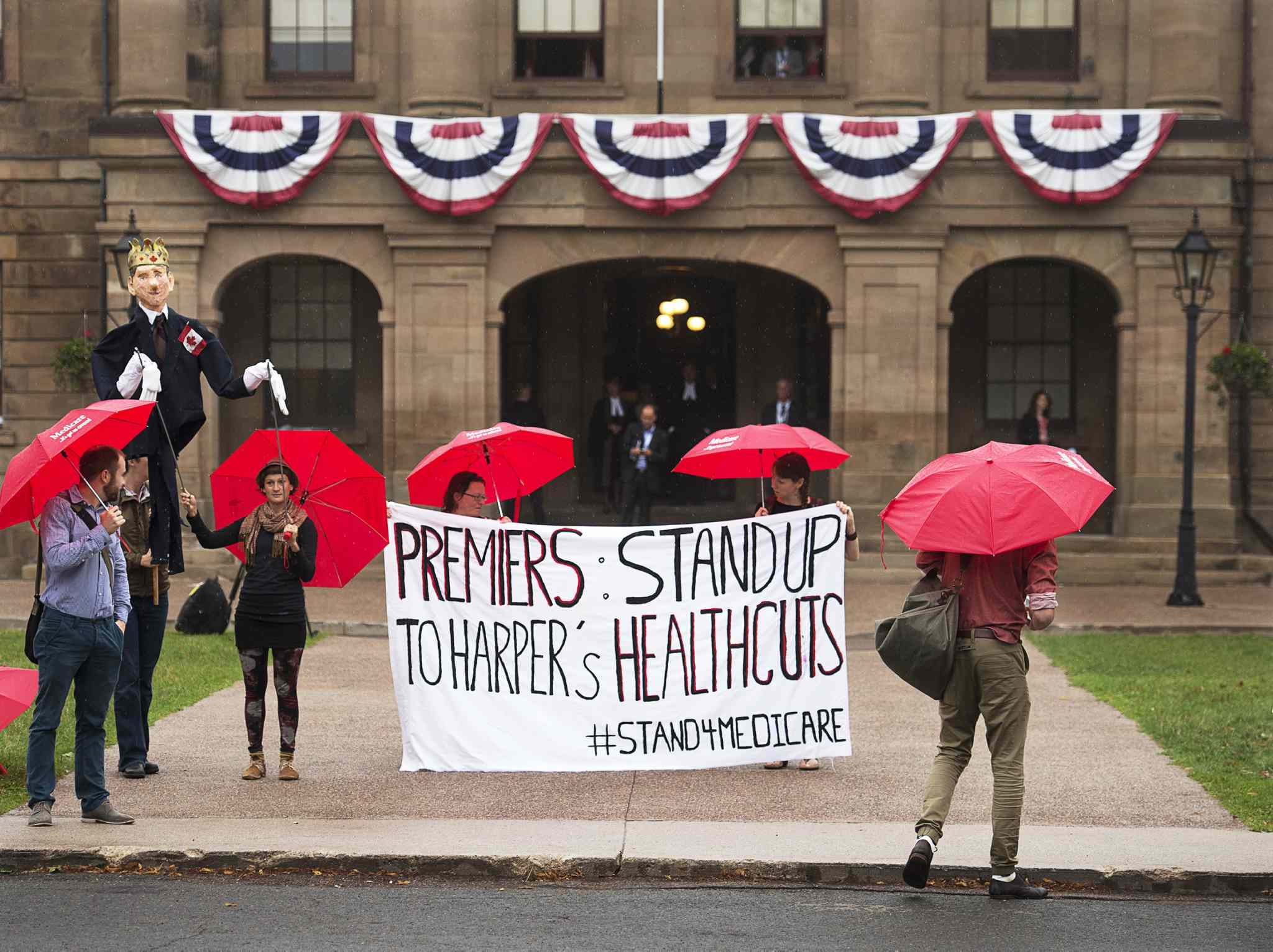 Protesters at a premiers' meeting in Charlottetown in 2014. Prime Minister Stephen Harper has refused to attend first ministers' meetings.