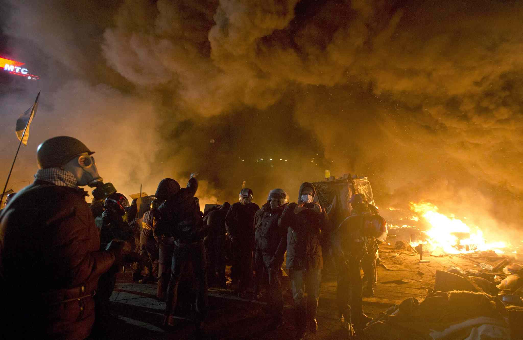 Anti-government protesters clash with riot police in Kiev's Independence Square, the epicentre of the country's current unrest. Thousands of police armed with stun grenades and water cannons attacked the large opposition camp in Ukraine's capital on Tuesday that has been the centre of nearly three months of anti-government protests after several people were killed in street clashes.