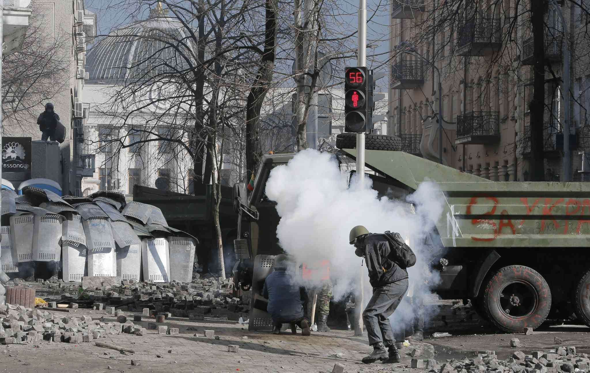 Anti-government protesters clash with riot police outside Ukraine's parliament in Kyiv on Tuesday.