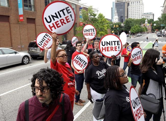 Union activists stand in the road as they participate in a protest by Philadelphia Council AFL-CIO Wednesday, June 27, 2018 in Philadelphia. The protesters denounced Wednesday's U.S. Supreme Court ruling that government workers can't be forced to contribute to labor unions that represent them in collective bargaining, dealing a serious financial blow to organized labor. (AP Photo/Jacqueline Larma)