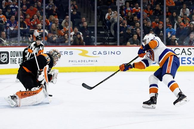 New York Islanders' Jordan Eberle, right, scores a goal against Philadelphia Flyers' Brian Elliott during a shootout in an NHL hockey game, Saturday, Nov. 16, 2019, in Philadelphia. New York won 4-3. (AP Photo/Matt Slocum)
