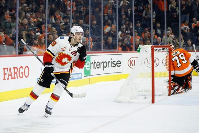 Calgary Flames' Matthew Tkachuk (19) reacts after scoring a goal against Philadelphia Flyers' Carter Hart (79) during a shootout in an NHL hockey game, Saturday, Nov. 23, 2019, in Philadelphia. Calgary won 3-2. (AP Photo/Matt Slocum)