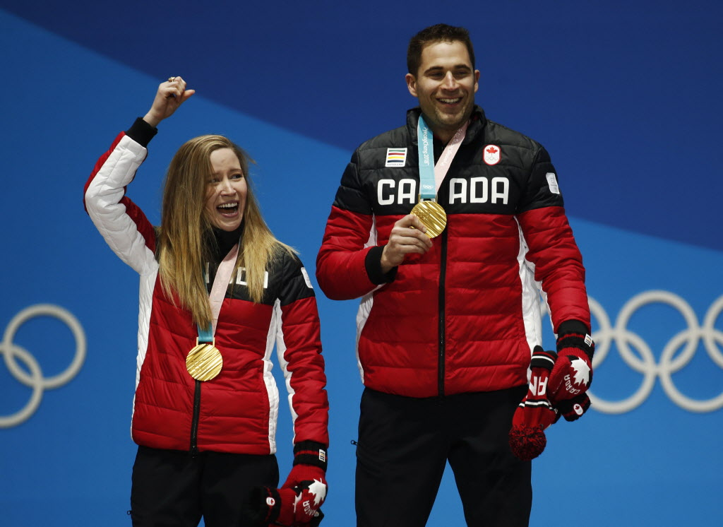 Curling mixed doubles gold medalists Kaitlyn Lawes, left, and John Morris. (Patrick Semansky / The Associated Press)