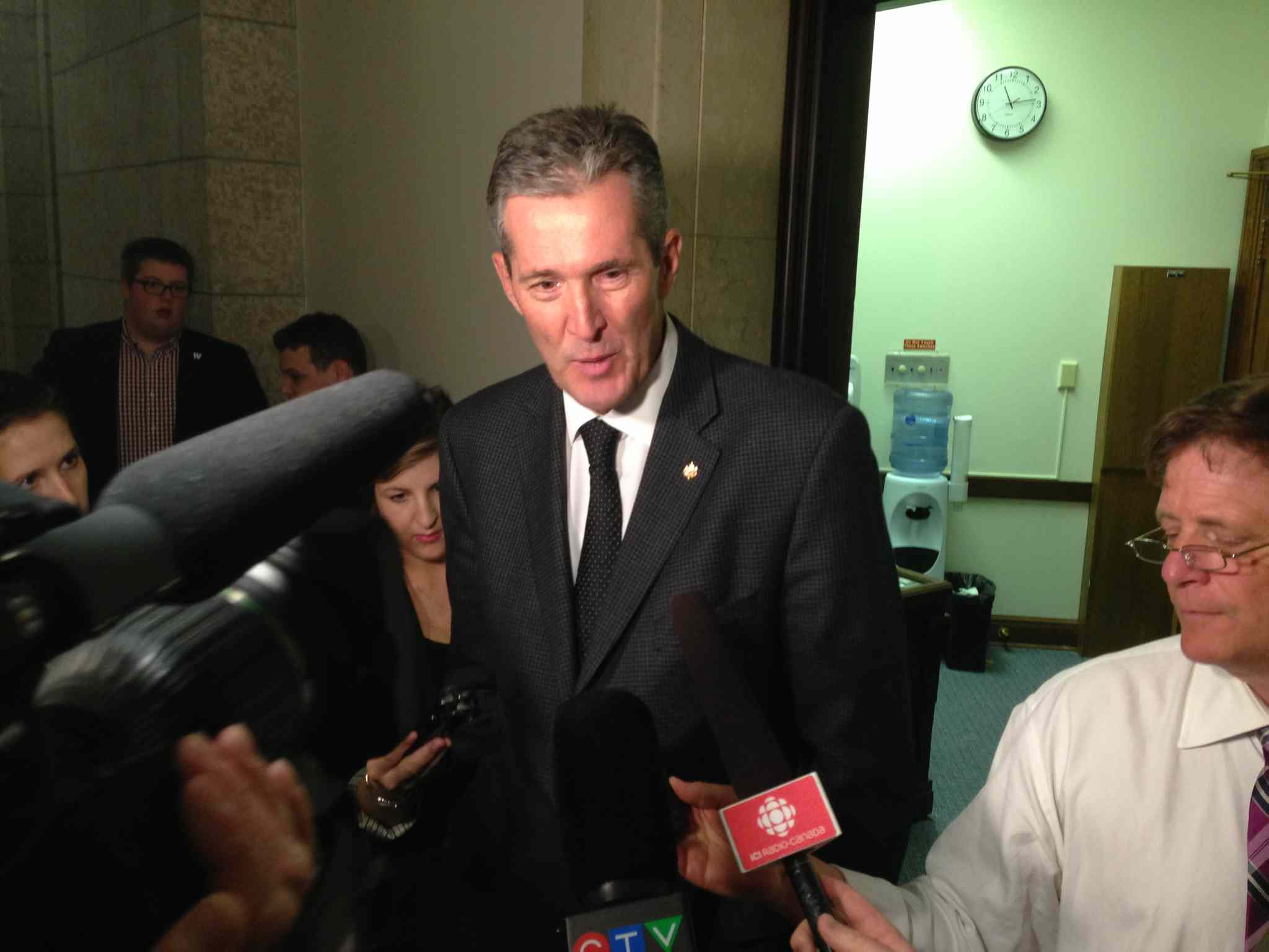 Brian Pallister speaks to reporters Friday.