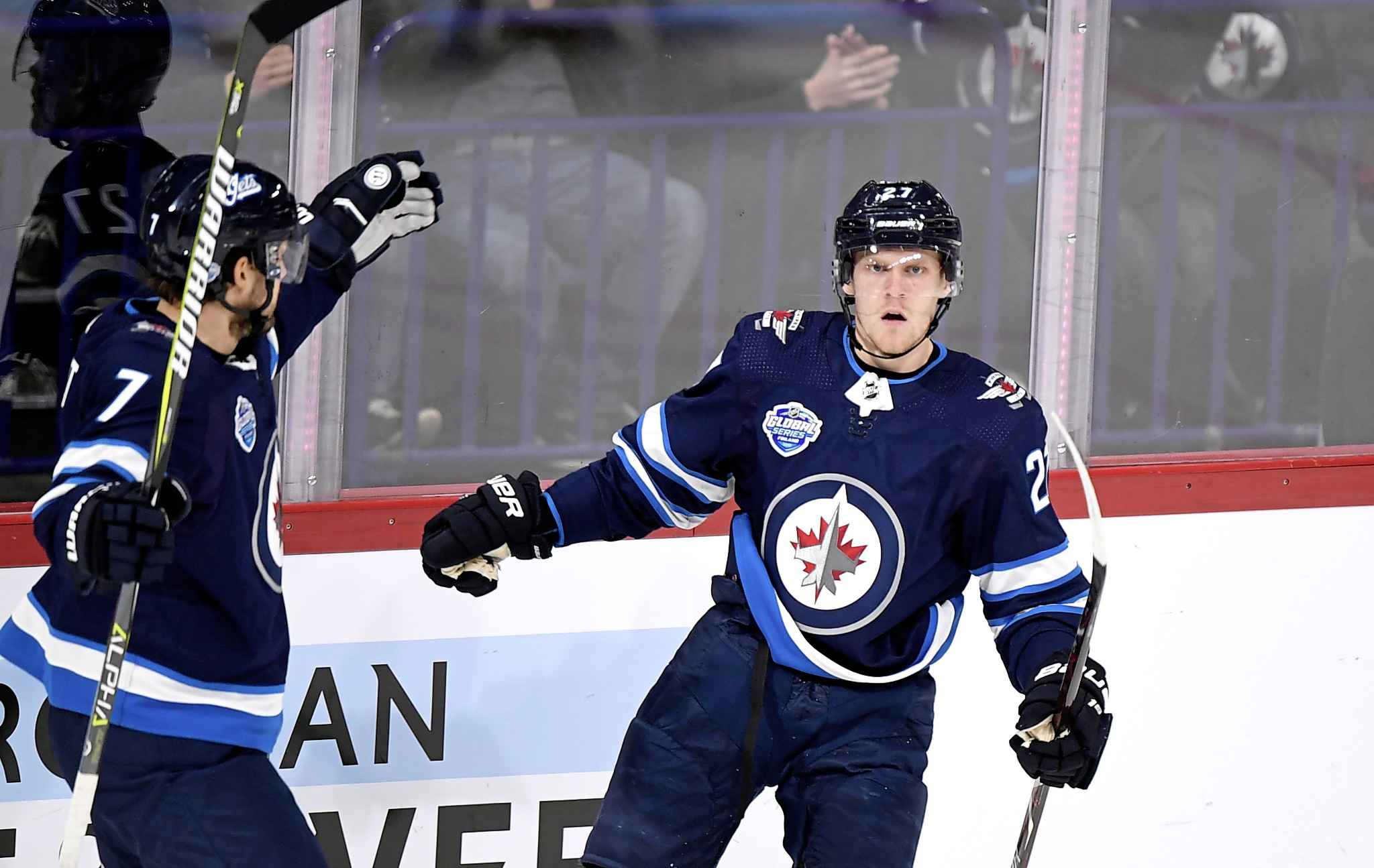 Nikolaj Ehlers celebrates the Jets' first goal Friday with Ben Chiarot. (Martti Kainulainen / Lehtikuva)