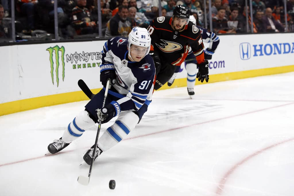 Jets rookie Cole Perfetti had family in the stands for his NHL debut Wednesday night in Anaheim. (AP Photo/Alex Gallardo)
