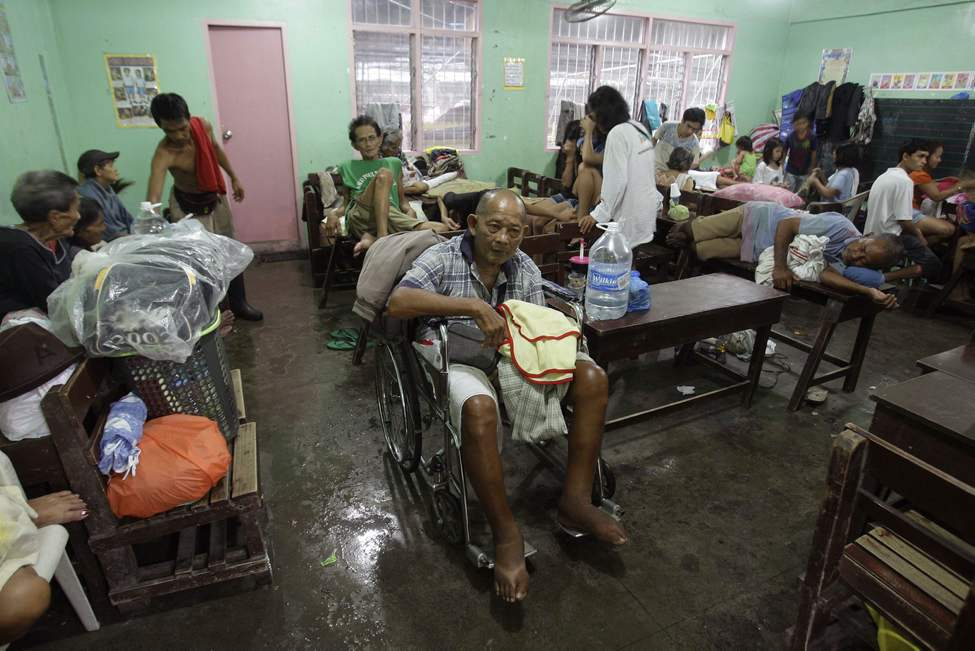 Senior residents stay inside a room at a school converted into a temporary evacuation center in Marikina City, east of Manila, Philippines, on Wednesday Aug. 8, 2012.  Widespread flooding that killed at least 11 people, battered a million others and paralyzed the Philippine capital began to ease Wednesday as cleanup and rescue efforts focused on a large number of distressed residents, some still marooned on their roofs.  AP Photo / Aaron Favila