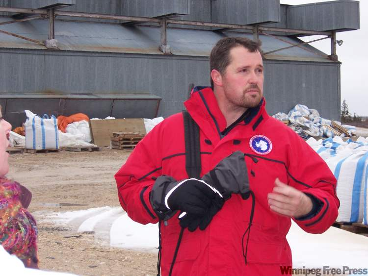 "Bear specialist Rupert Pilkington leading outdoor tour of Churchill Northern Studies Centre with rife on his shoulder. The weapon was loaded with ""bear bangers"" in case we encountered a polar bear, which wander onto the property at this time of year."