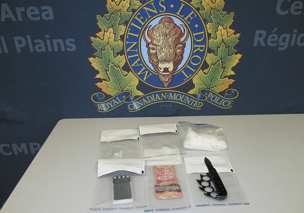 Methamphetamine, an unknown substance, and a weapon seized from a vehicle outside Portage la Prairie Saturday.