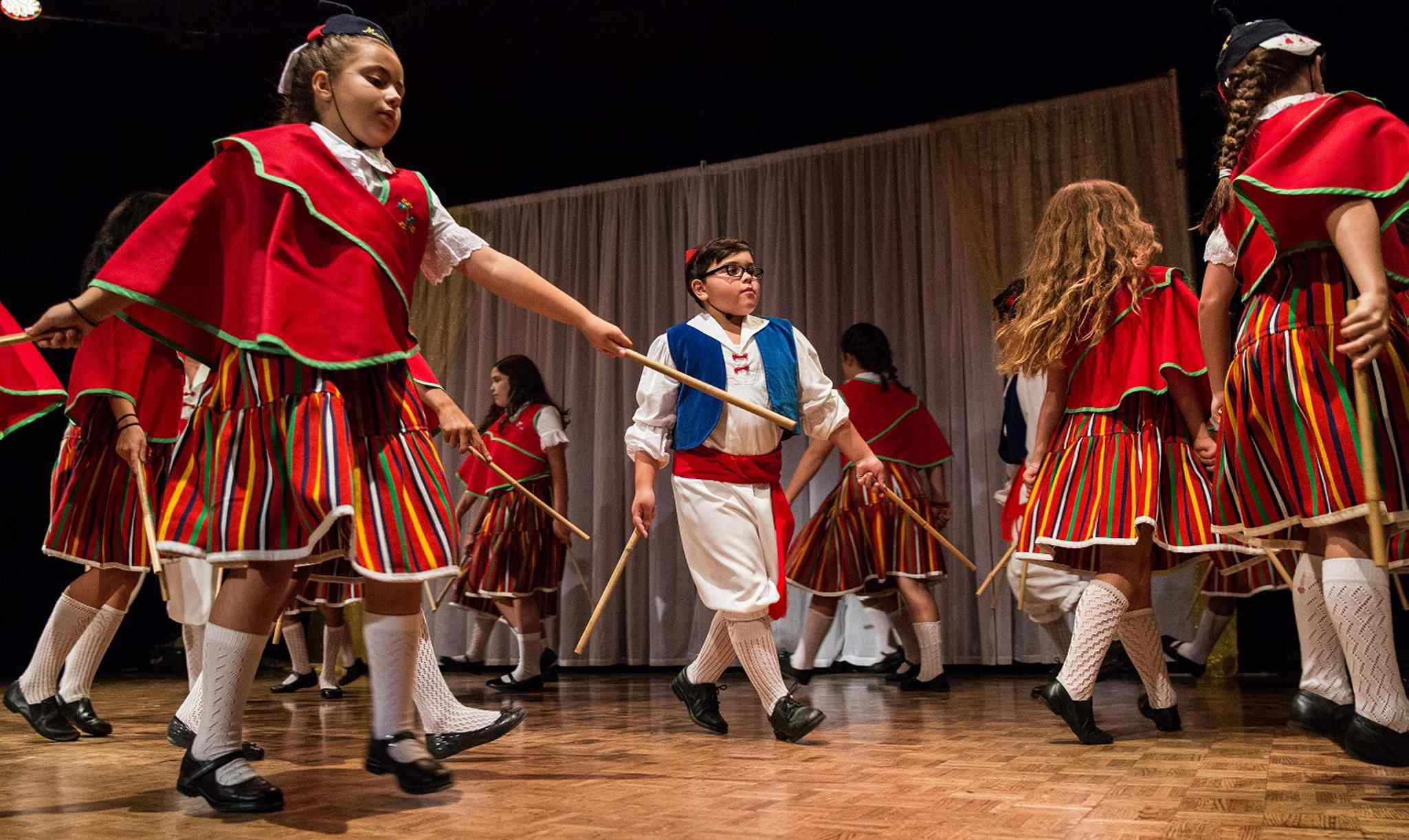 MIKE DEAL / WINNIPEG FREE PRESS Ben MacPhee-Sigurdson takes us on a tour of Folklorama pavilion's to sample various drinks and food. Young dancers perform at the Pavilion of Portugal Tuesday evening. 160809 - Tuesday, August 09, 2016