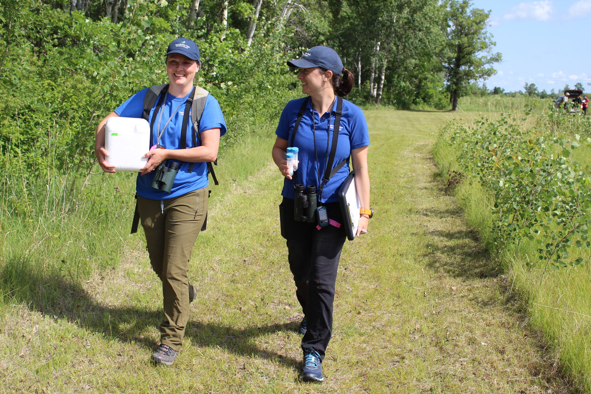C-Jae Breiter and Laura Burns carry a Stryofoam cooler and other equipment out to the preserve last Thursday.
