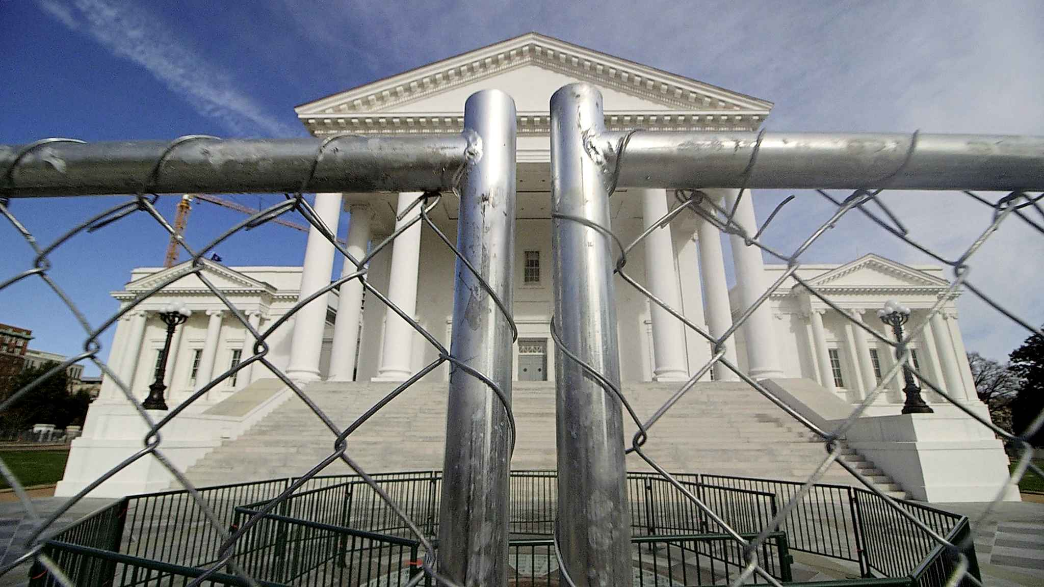 The Virginia state Capitol building is surrounded by fencing, Thursday, in Richmond, Va., in preparation for Monday's rally by gun rights advocates. (Dean Hoffmeyer / Richmond Times-Dispatch)