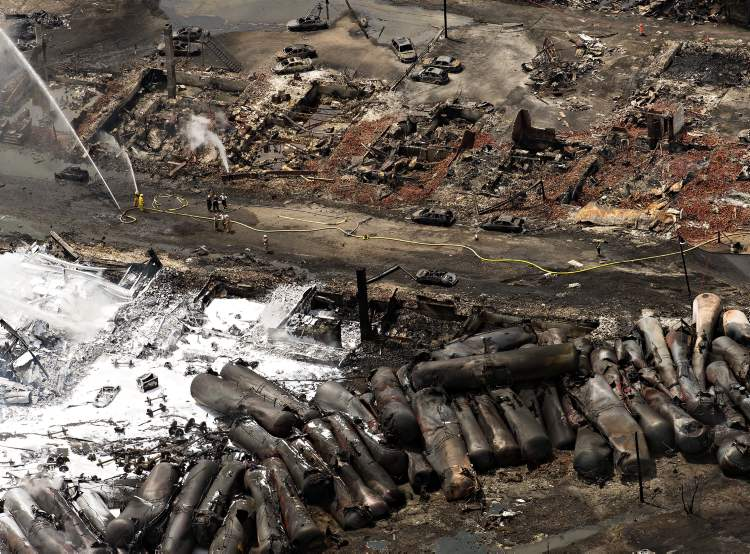 Downtown Lac Megantic, Que., lies in ruins as firefighters water smouldering rubble Sunday after the explosion of tanker cars carrying crude oil on Saturday.