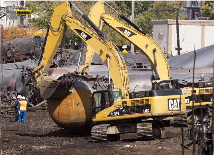 Mechanical diggers clanged as they dug through the rubble alongside a group of a dozen firefighters and search crews. Those crews found one more body Tuesday — the 38th recovered on the site. Fifty people are believed to have died in the disaster.
