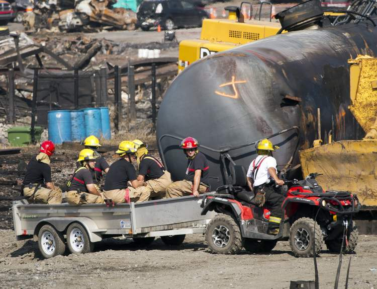 Police gave strict instructions about what images could be shown for fear of upsetting the families of victims, or compromising the investigation. Only one TV cameraman, one web-video journalist, one photographer, and one radio reporter were allowed to record inside the perimeter. The images gathered from Tuesday morning's media pool were shared with other news outlets, then released to the public. (Ryan Remiorz / The Canadian Press)