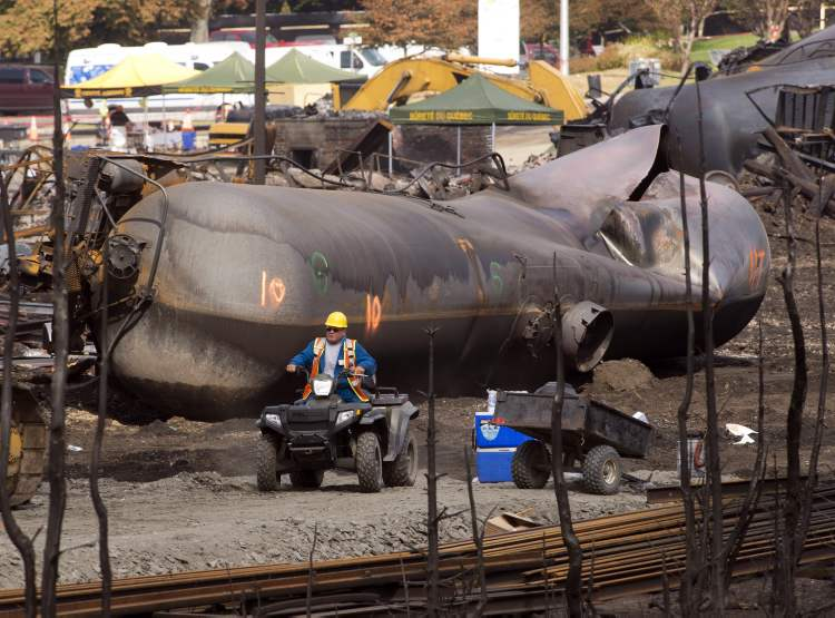 Burnt rail tankers are still steaming with heat, a week after the explosions. The temperature near the blast site remains, according to authorities, 10 to 20 degrees higher than elsewhere. (Ryan Remiorz / The Canadian Press)