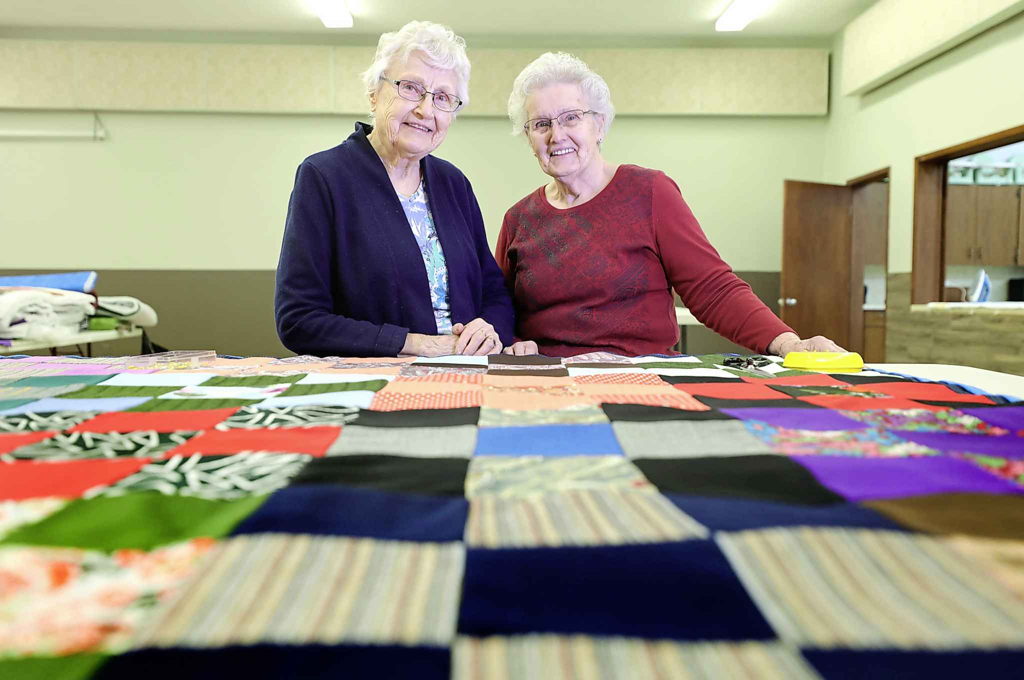 Two of the three women who started the quilting circle over 40 years ago, Trudy Rempel, left, and Hilda Wiebe.