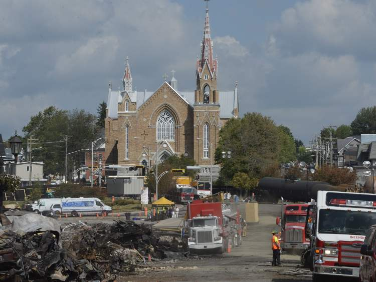 The aftermath of a train derailment and fire is seen in Lac-Megantic, Que., on Tuesday, July 16, 2013.  (Ryan Remiorz / The Canadian Press)