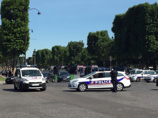 Car rams police van on Champs-Elysees, suspect dead