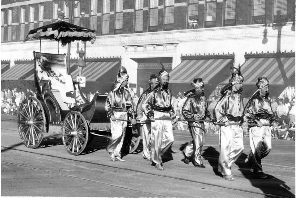 Scimitar-wielding members of the Ancient Mystic Order of Samaritans cut a swath down the Red River Exhibition Parade route July 24, 1954.