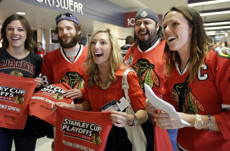 Chicago Blackhawks fans arrive at United Center for the big game.