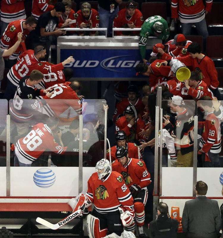 The Chicago Blackhawks take to the ice for warmups before Game 7. (Nam Y. Huh / The Associated Press)