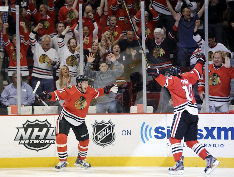 Chicago Blackhawks center Patrick Sharp (10) celebrates with winger Marian Hossa (81) after scoring a goal against the Detroit Red Wings during the second period. The Blackhawks went to the dressing room with a 1-0 over the Red Wings after 40 minutes of play.
